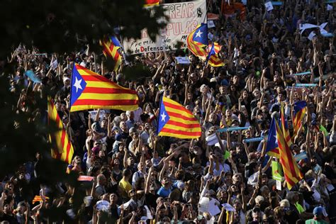 The Latest: Catalan leader urges strong response to Spain