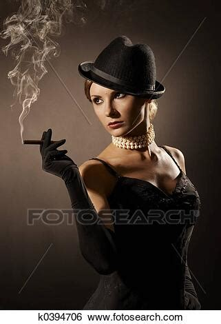 Stock Images of lady and cigar k0394706 - Search Stock